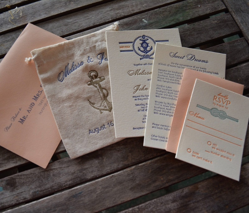 Custom letterpress printed nautical wedding invitation suite in peach and navy with a rustic mulsin bag to hold the suite by Lucky