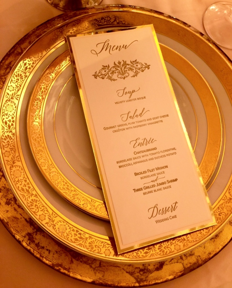 Letterpress wedding menu in gold by Lucky Invitations.