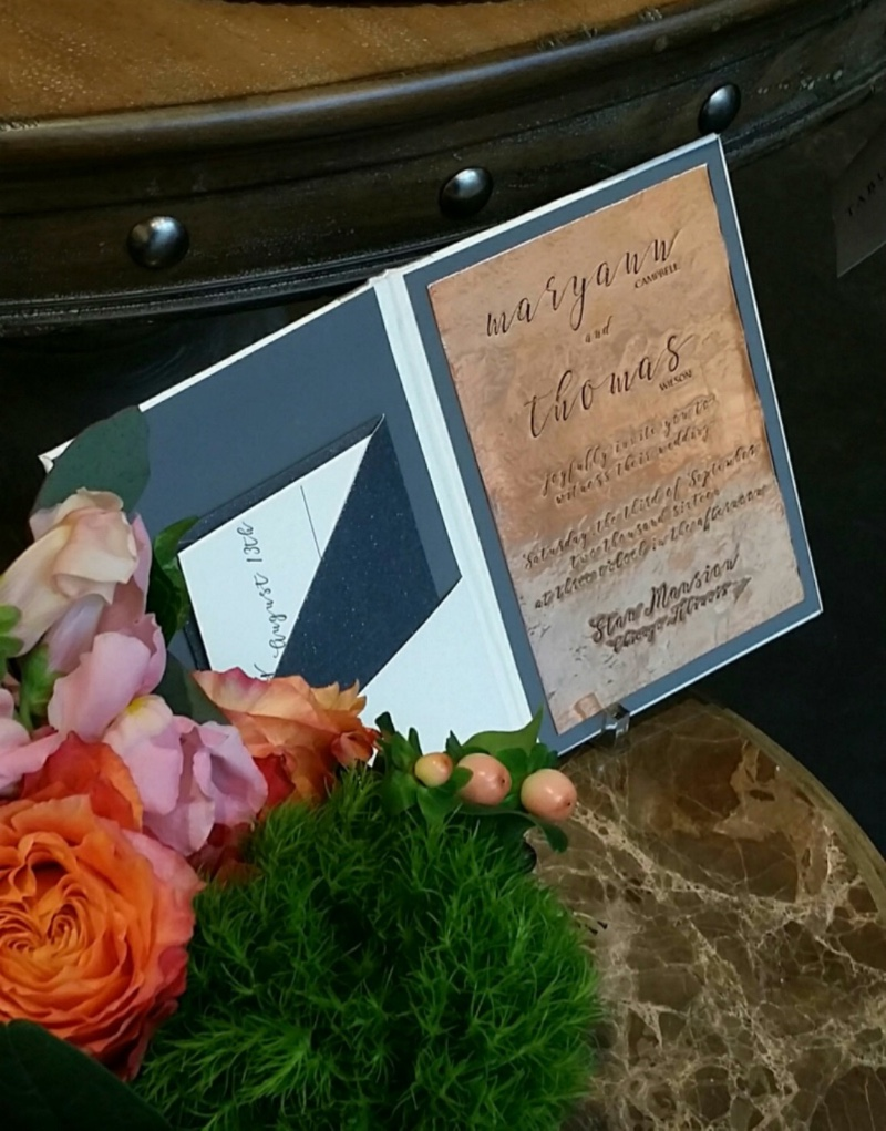 Letterpress invitation printed on hand-hammered copper, by Lucky Invitattions.