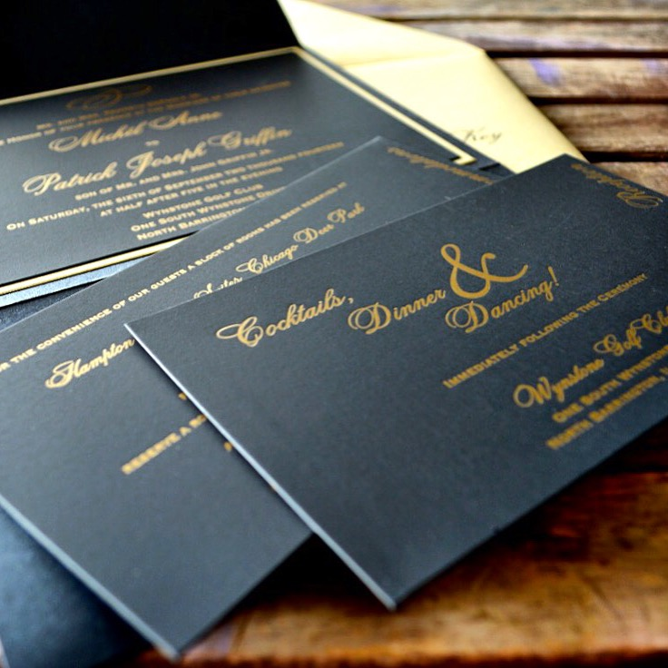 Black and gold letterpress wedding invitation suite by Lucky Invitations.
