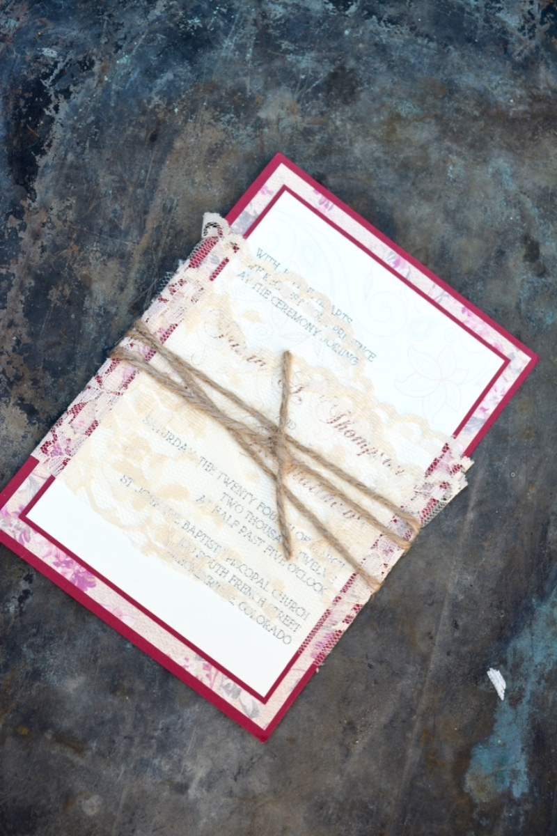 This lace and twine wrapped wedding invitation is perfect for a rustic fall wedding. By Lucky Invitations.
