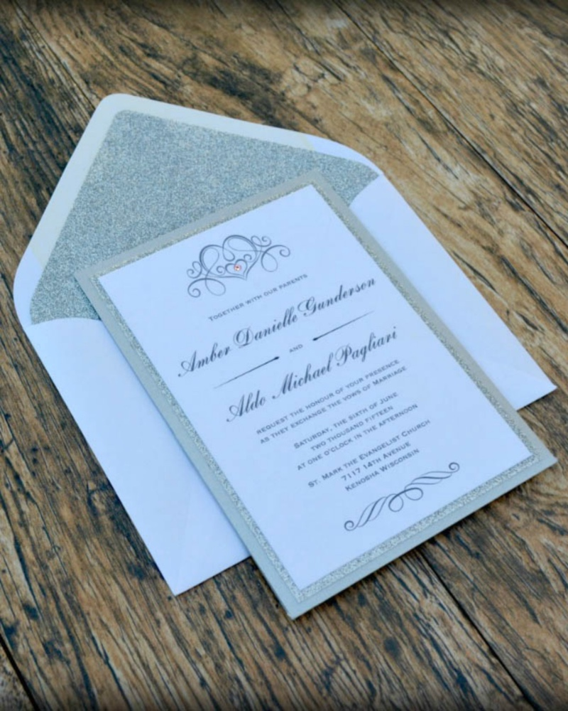Classic silver and white wedding invitation with a bit of bling, by Lucky Invitations.