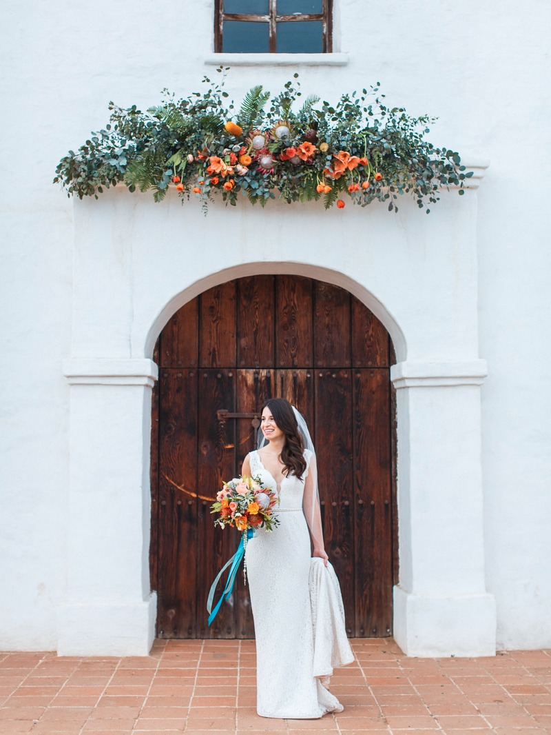 A beautiful Santa Barbara bride at El Presidio with amazing floral design by Coco Rose Design.