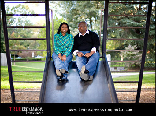 engagement photo of couple at a playground