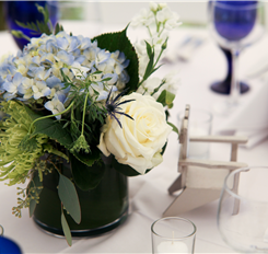blue hydrangea centerpiece with white roses