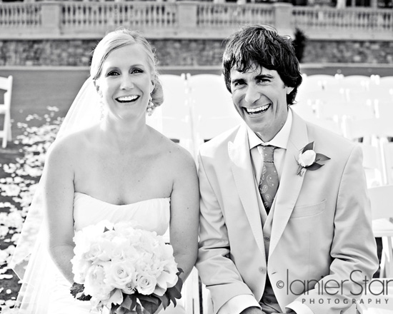 bride and groom laughing after wedding