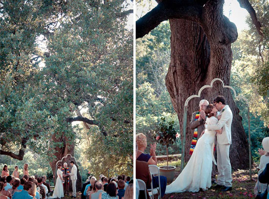 groom kisses his bride under an oak tree in austin tx