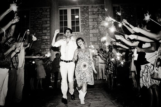 bride and groom exiting reception with sparklers