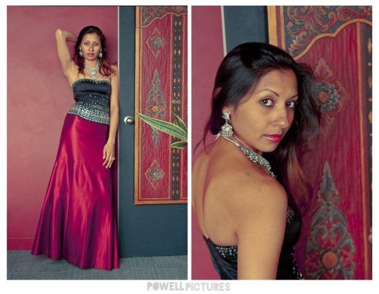 beautiful Indian bride standing against a red wall