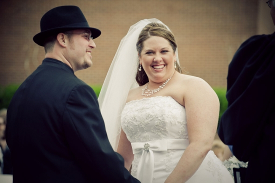 bride and groom smiling during outdoor wedding ceremony in grapevine, tx