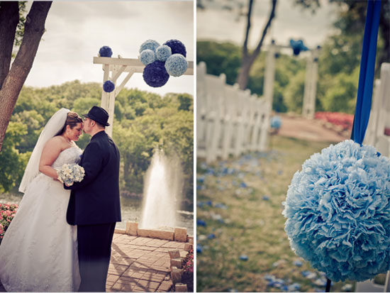 bride and groom kissing at altar decorated in blue