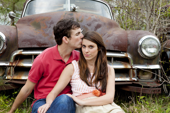 couple in front of old car