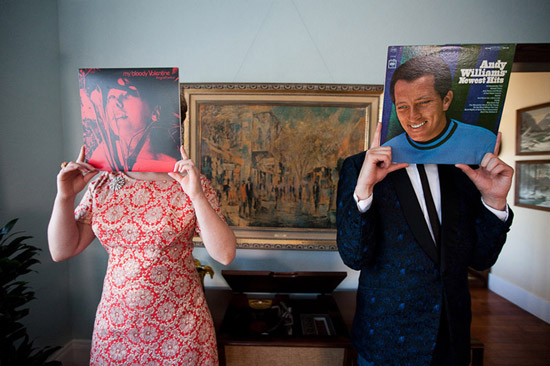 Sixties engagement session. Couple with records at home