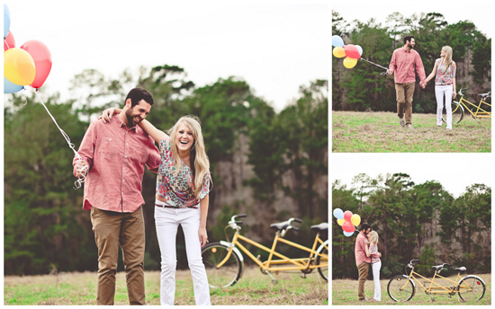 A couple kisses next to a yellow tandem bike with bright balloons.