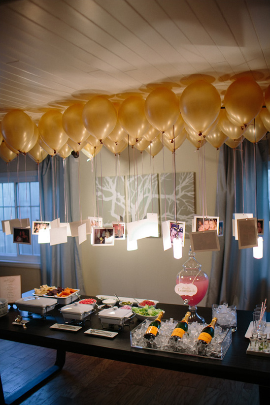 gold balloons with pictures hanging from them