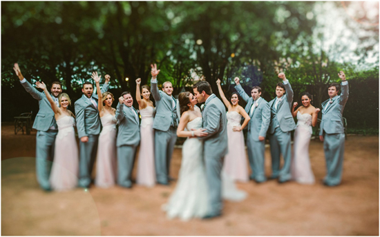 Bridal party cheer for the bride and groom at the Hoffman Haus.