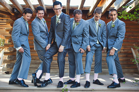 grooom and his men with pink socks