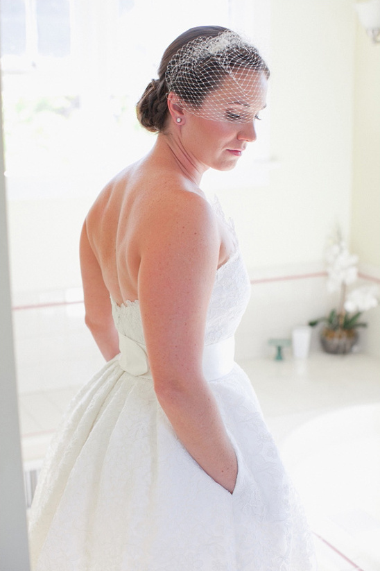 strapless tea length wedding gown paired with bird cage veil