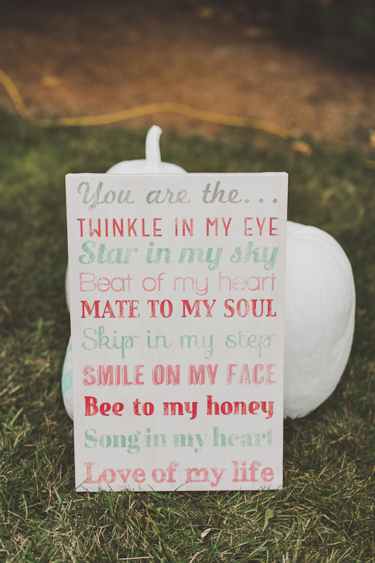 teal and red wedding sign