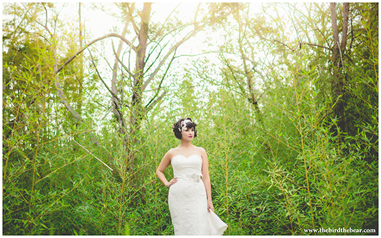 A bride in Austin, Texas stands in the trees.