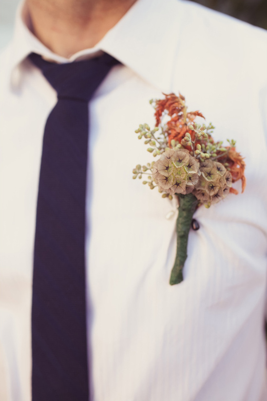 pink and peach groomsmen boutonniere