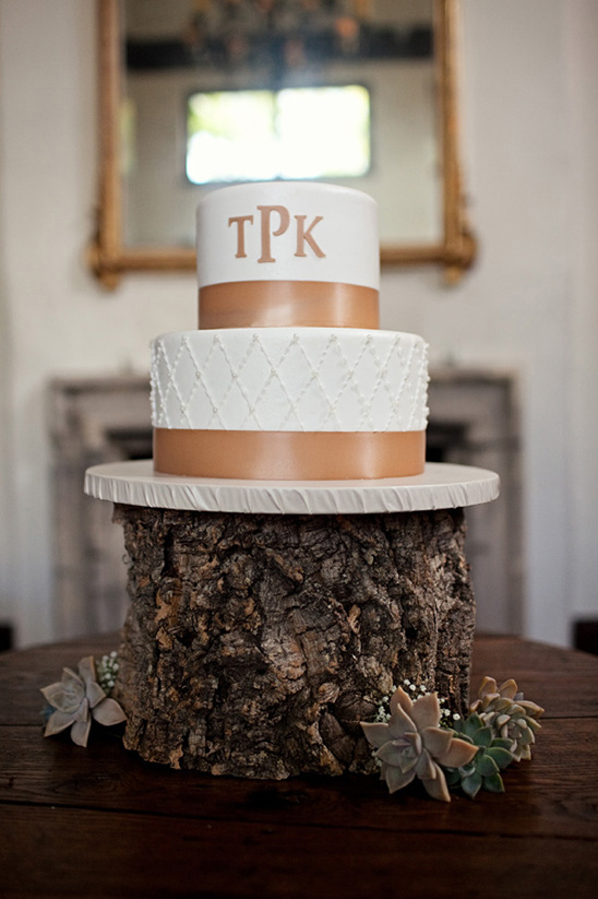 white and brown wedding cake by It's All about the Cake