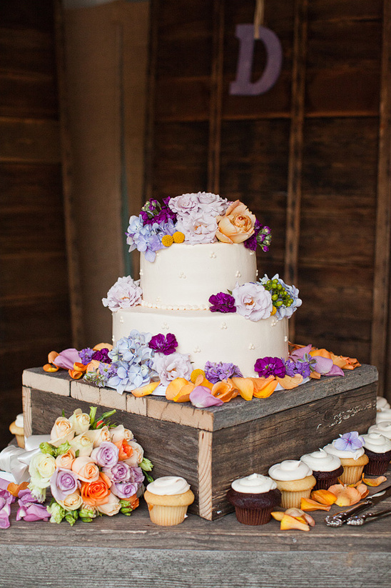peach and purple wedding cake by Mazzetti's Bakery