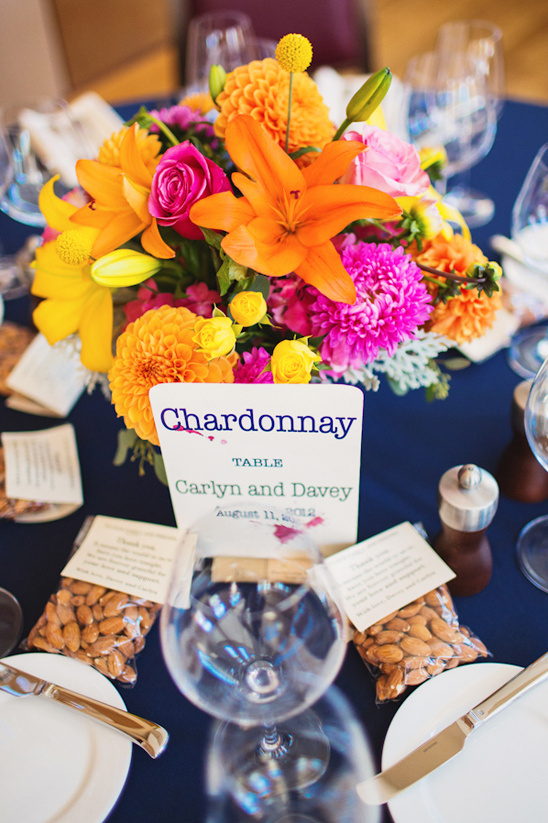 orange, pink and yellow table arrangements by Stems Floral