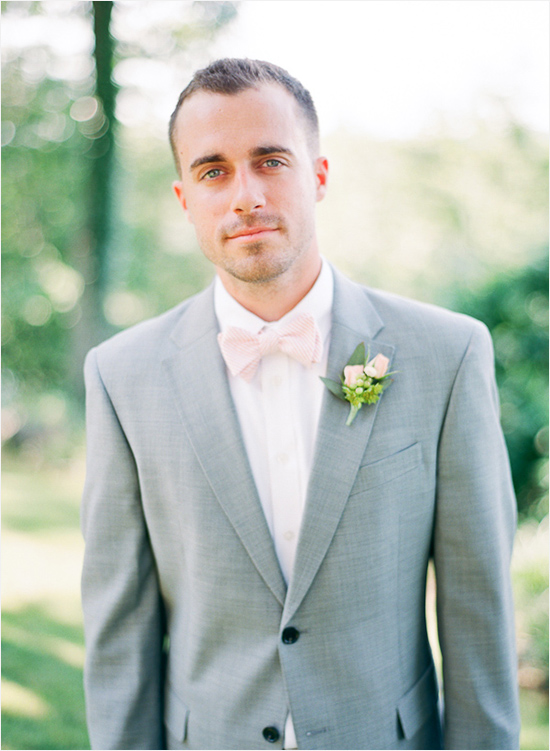 groomsman in gray suit with pink bow tie