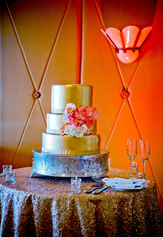 gold wedding cake by La Valencia Hotel