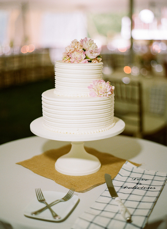 white and pale pink wedding cake by Delicious Desserts