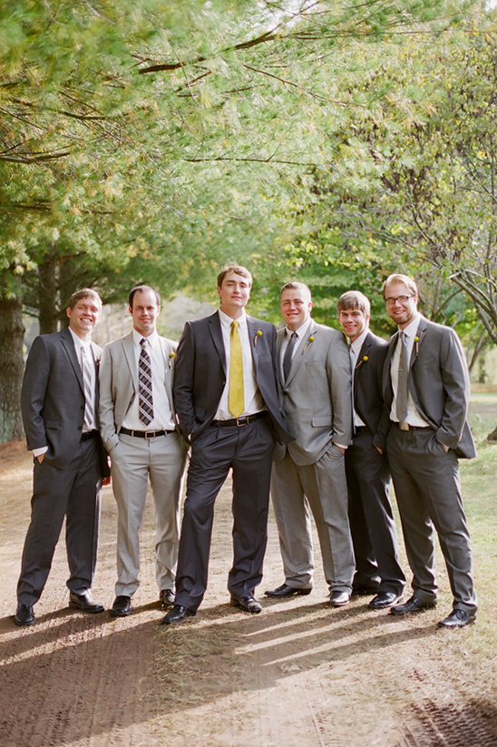 gray groomsman in Giorgio Cosani suits