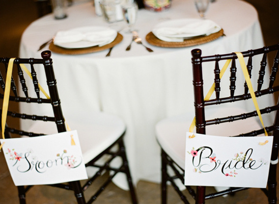sweetheart table bride and groom signs