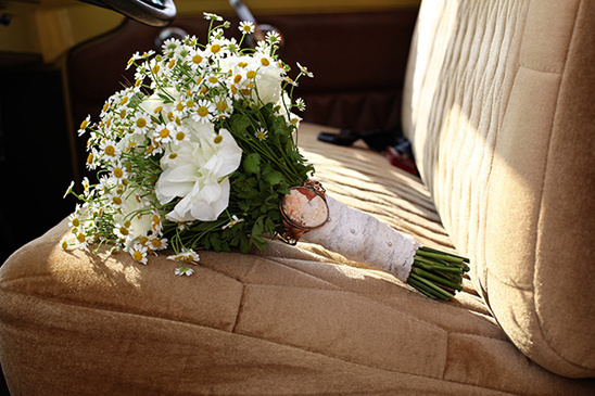 brooch attached to bridal bouquet