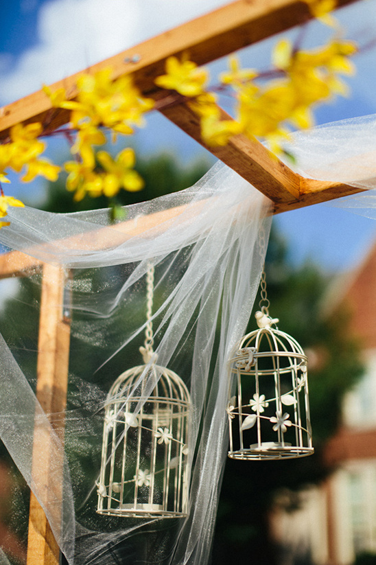 birdcages as ceremony decor