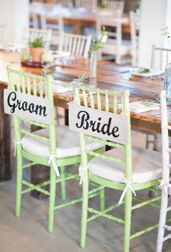 groom and bride sign