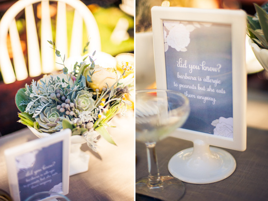 table signs with facts about the bride