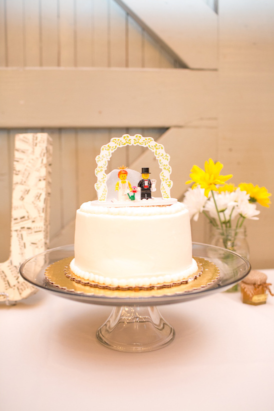 cake with lego cake topper by Yum Yum Cupcake Truck