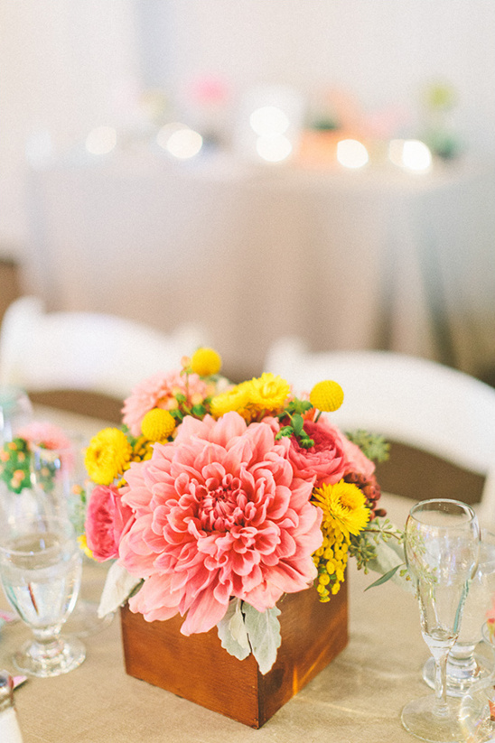 pink and yellow wedding floral arrangement
