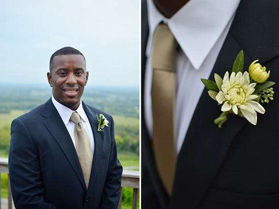 navy blue groomsman looks from Sarar