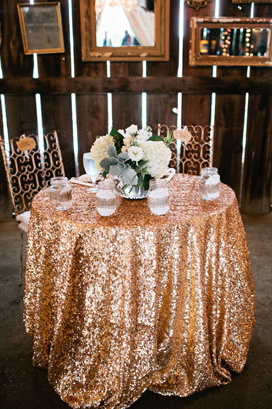 sweetheart table with gold tablecloth