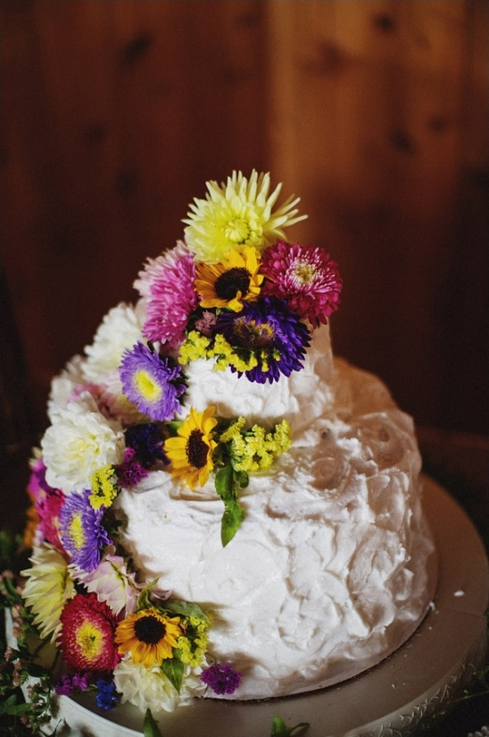 white wedding cake with wildflowers