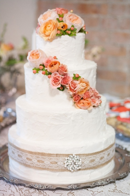 buttercream wedding cake with peach flowers