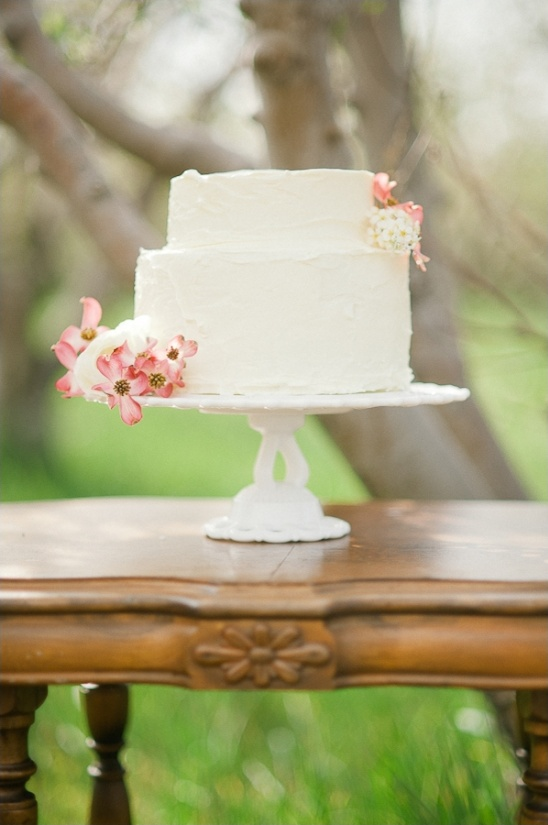 white wedding cake with floral decorations