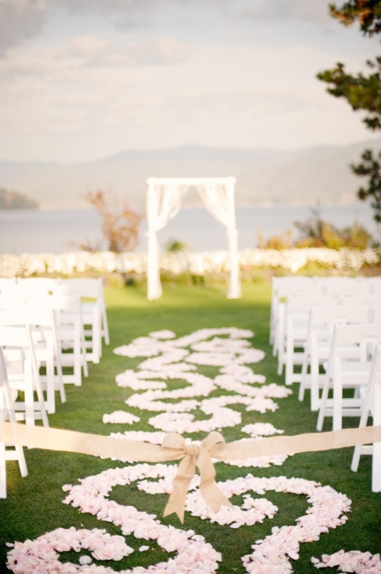 flower petal covered ceremony aisle
