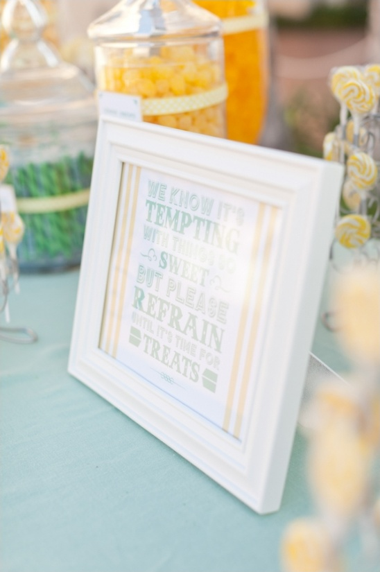 mint and yellow candy bar sign
