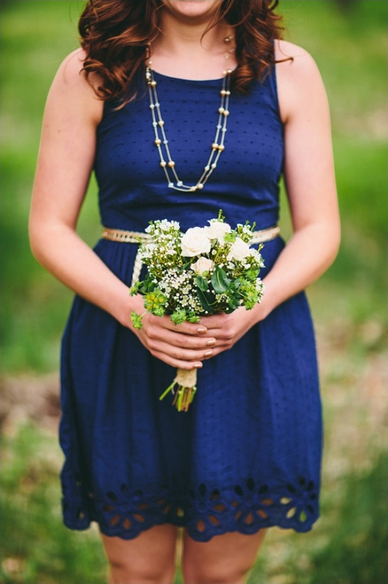 blue bridesmaid dress and white bouquet