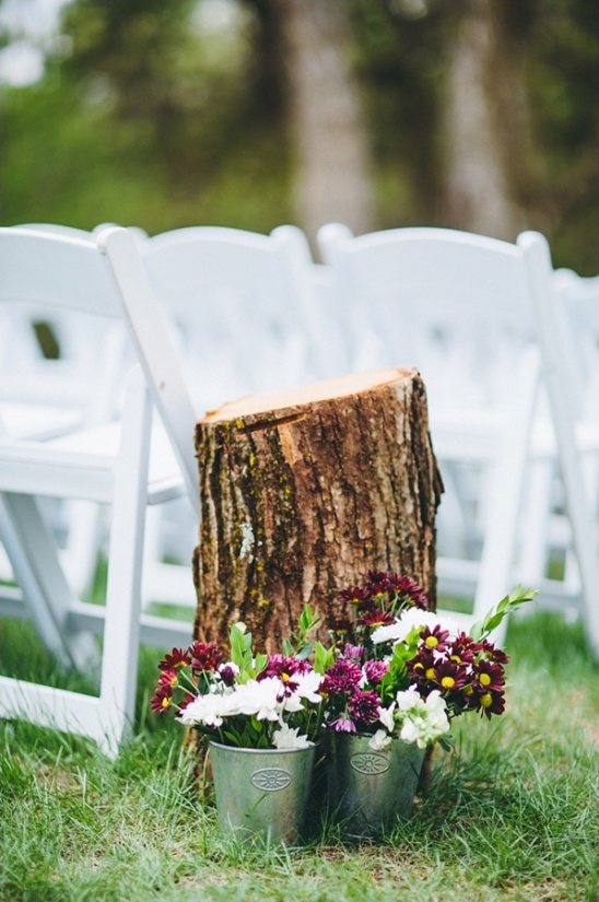 tree stump and floral pails