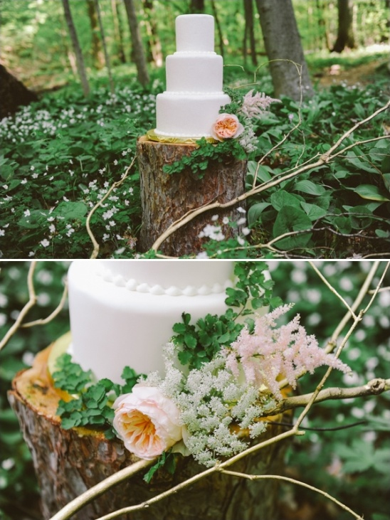tree stump as outdoor cake table
