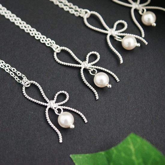 Bow charms with swarovski pearls necklaces from www.earringsnation.com
